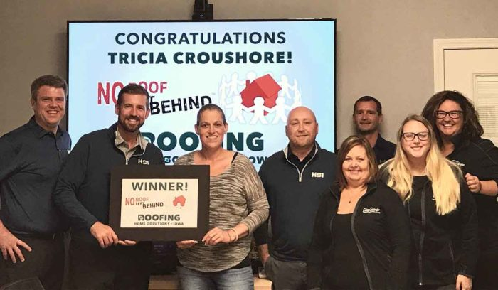 Pictured, No Roof Left Behind's winner Tricia and the team from Home Solutions of Iowa.