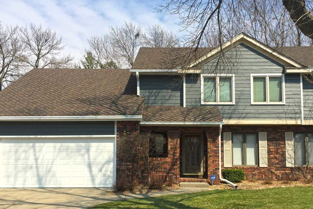 A house installed with Home Solutions of Iowa's siding, GAF roofing and LeafGuard® Gutters.