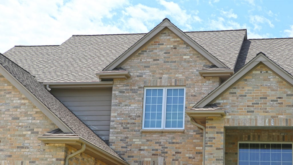 Timberline HD Shingles and LeafGuard Brand Gutters in Urbandale, IA