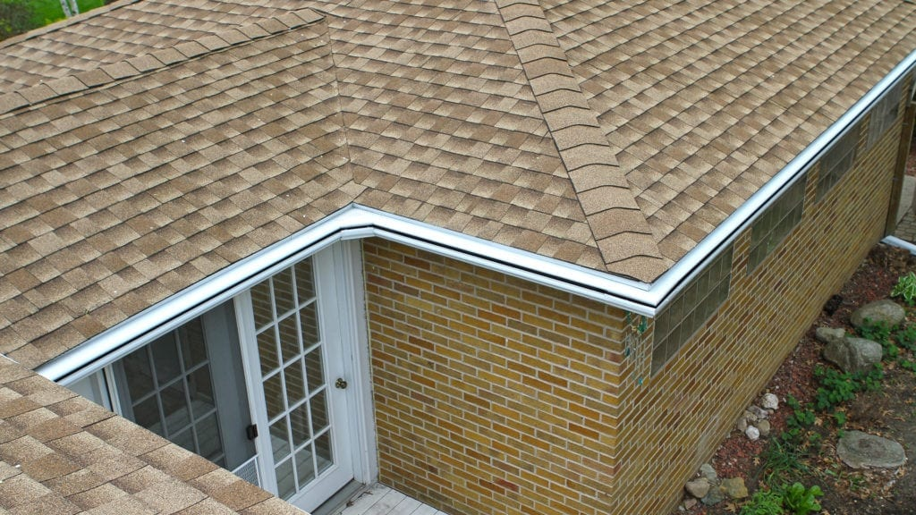 Rooftop view of LeafGuard Brand Gutter system and miters on this Adel, IA home