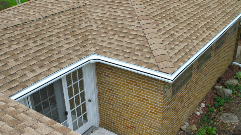 Rooftop view of LeafGuard Brand Gutter system and miters on this Adel, Iowa home