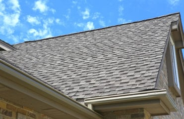 A home with GAF roofing and LeafGuard® gutters installed.