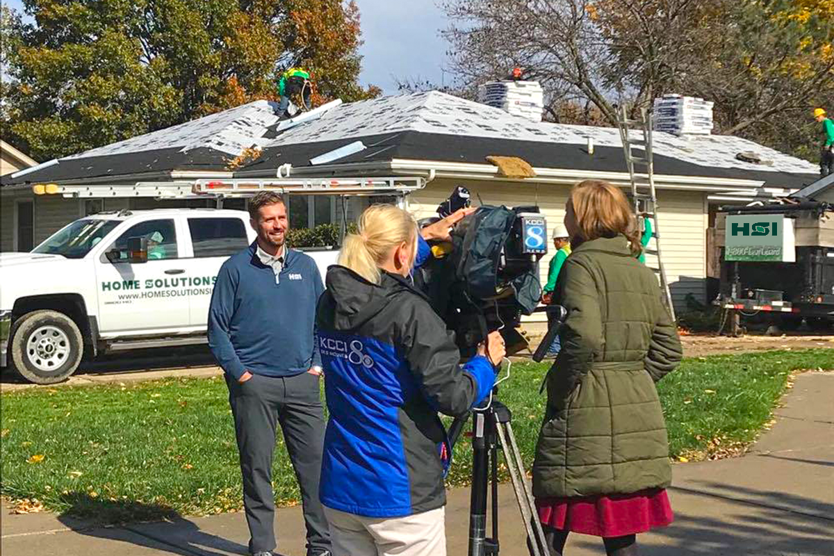 Joe Smith, President of Home Solutions of Iowa, being interviewed by KCCI newscast team for the No Roof Left Behind contest.