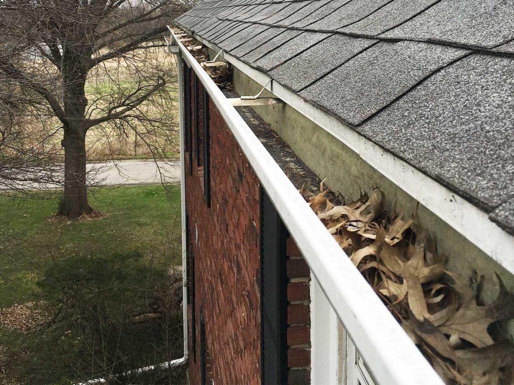 The clogged gutters on this Marshalltown, IA home caused foundation issues, overshooting rainwater, and negatively effected the overall appearance of the home.