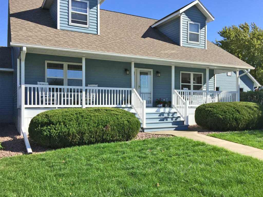 This Cape Cod style home is located in Pocahontas, IA custom fit with LeafGuard® Brand Gutters.