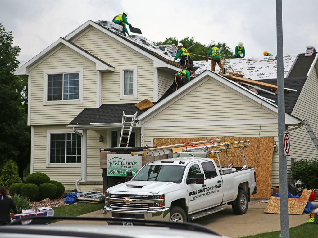 Roofers in Clive, Iowa.