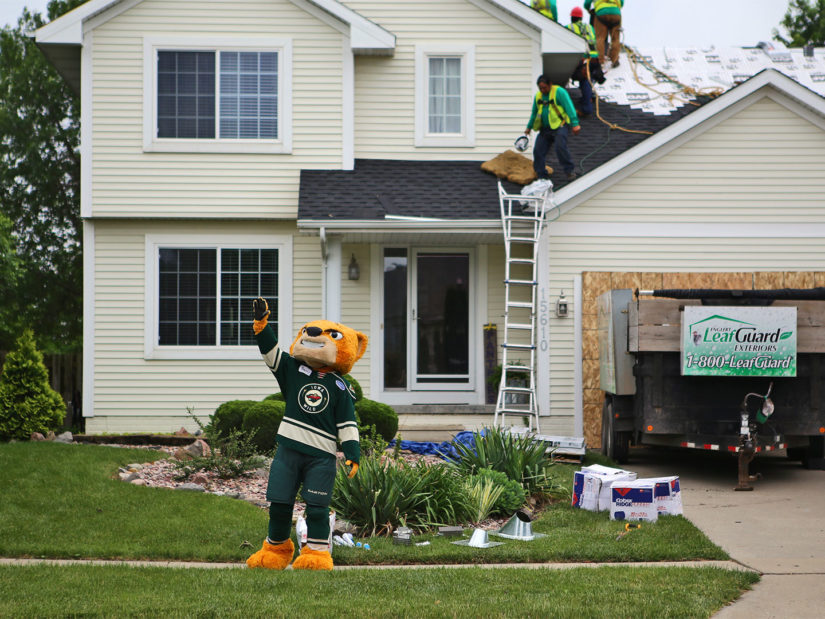 Crash, from the Iowa Wild celebrates with the neighborhood in Clive, IA