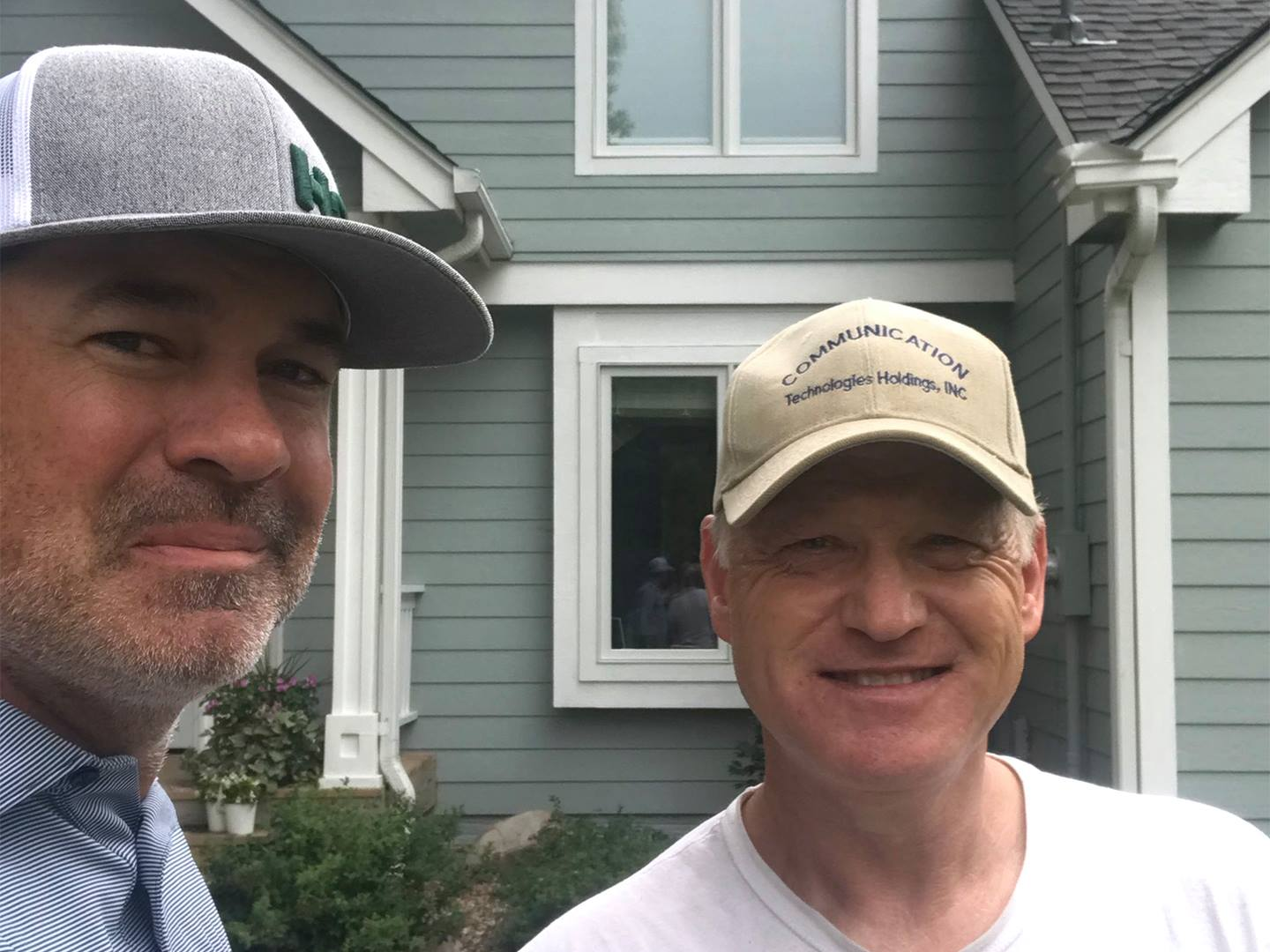 Pictured is Rocky, one of our Home Solution Experts stopping by to check in with Mike and the installation process of his new GAF® roofing and LeafGuard® gutter systems!