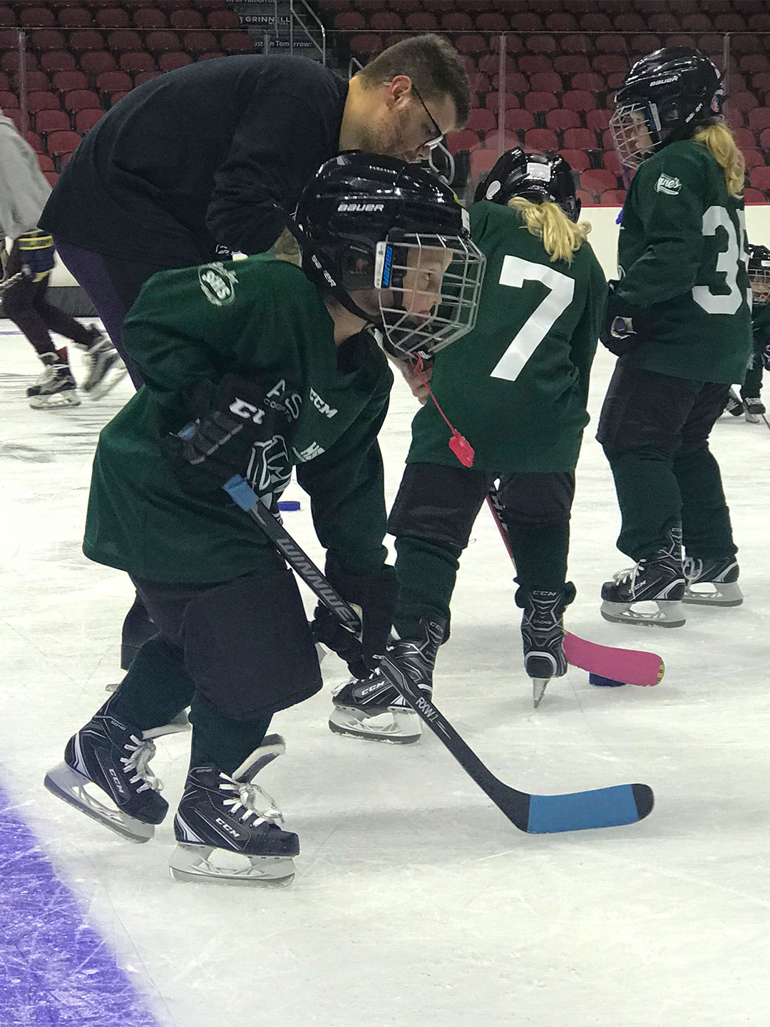 Young boy picking up some speed on the ice.