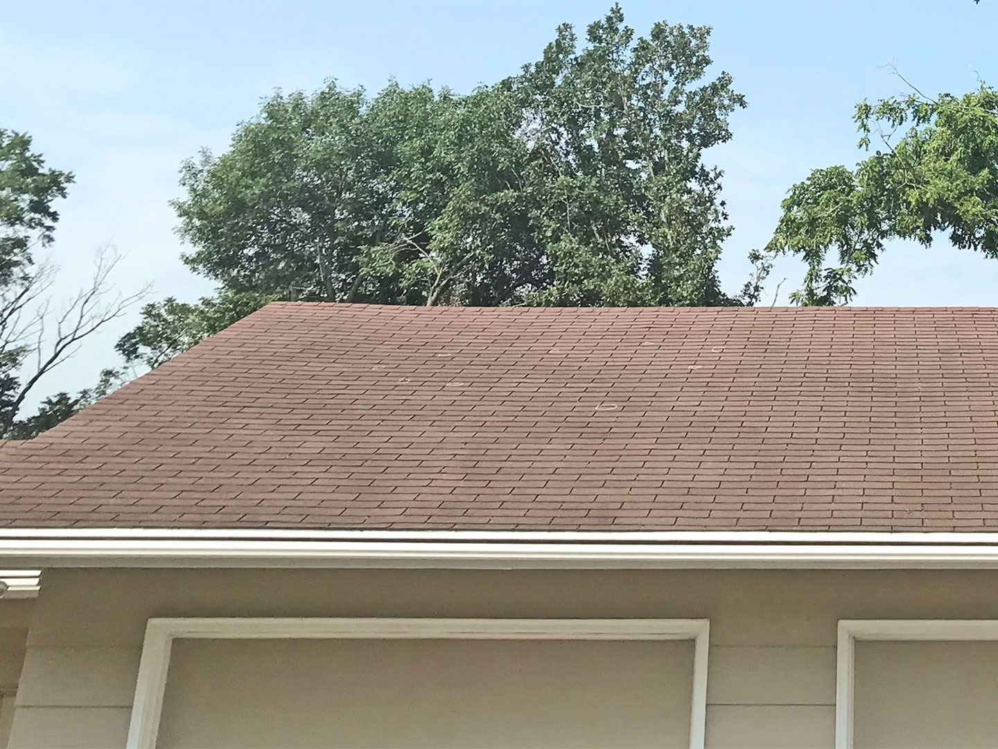 Roof Replacement in Nevada, Iowa due to hail damage.