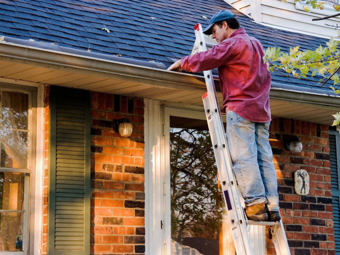 Climbing Ladder to Clean Clogged Gutter