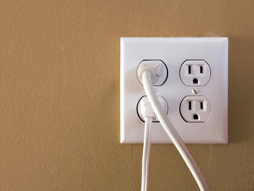 By placing a pre-cut foam gasket on the back side of the outlet cover, this will give you a tight seal to stop the air from coming in and out.