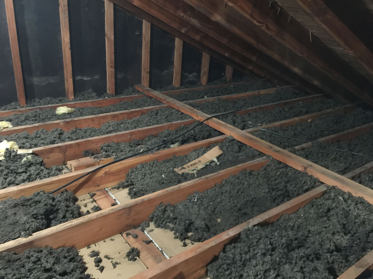 Charles' attic had a minimal amount of blown-in insulation.