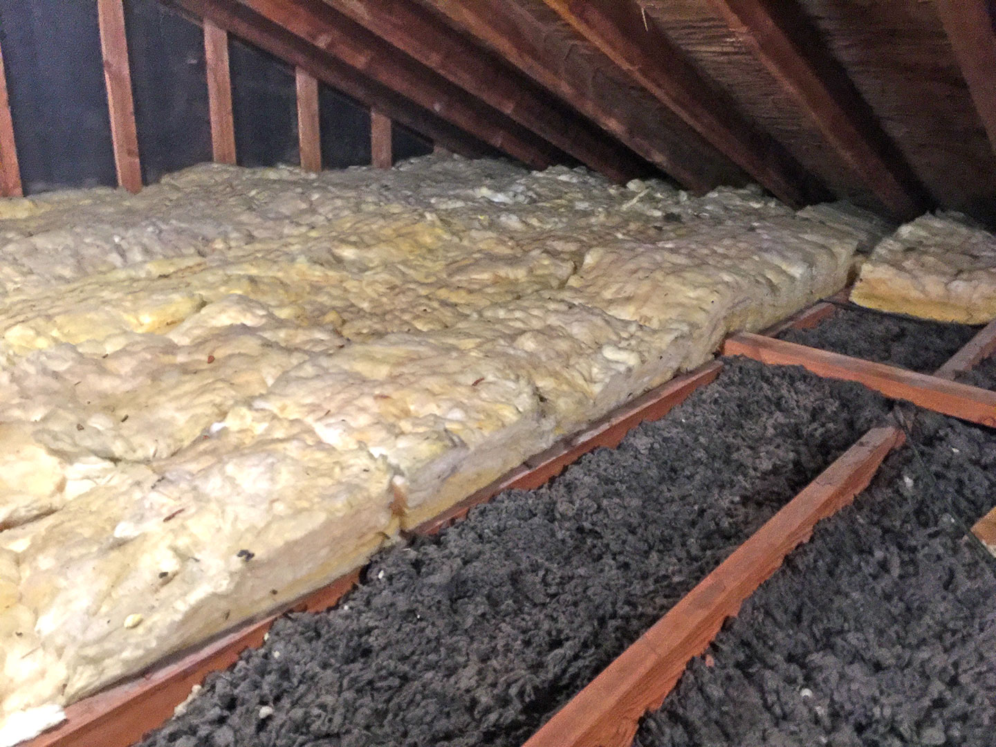 At one point batt insulation was added over the blown-in insulation to help improve the comfort of the home, when in fact there are air gaps between the rolls where they sit next to each other allowing heat to continue escaping.