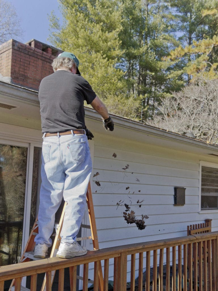 Climbing ladders to clean clogged gutters is a dangerous task.