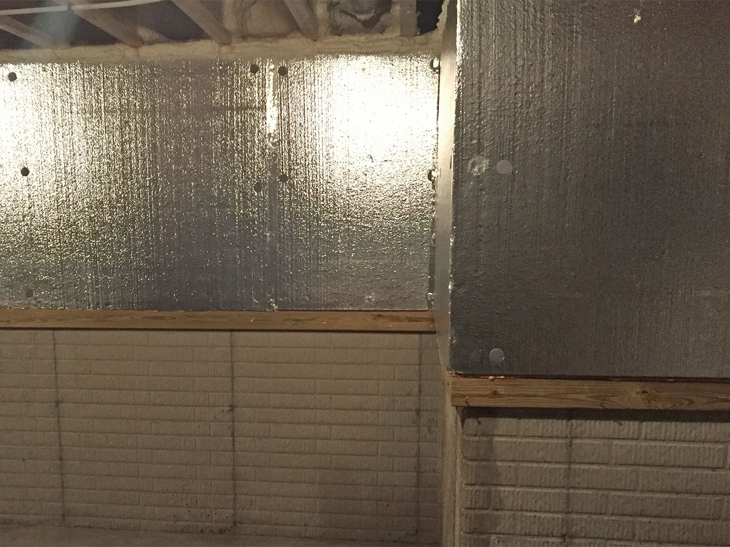 After the foam insulation was installed, above the rim joist was then air sealed and insulated with spray foam.