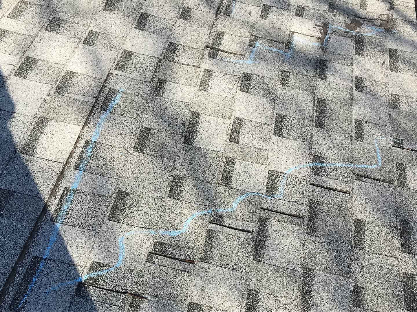 Because of the poor installation, the shingles were able to move and shift.