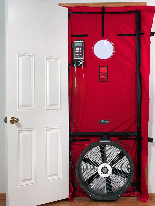 Pictured is a blower door set up in a doorway.