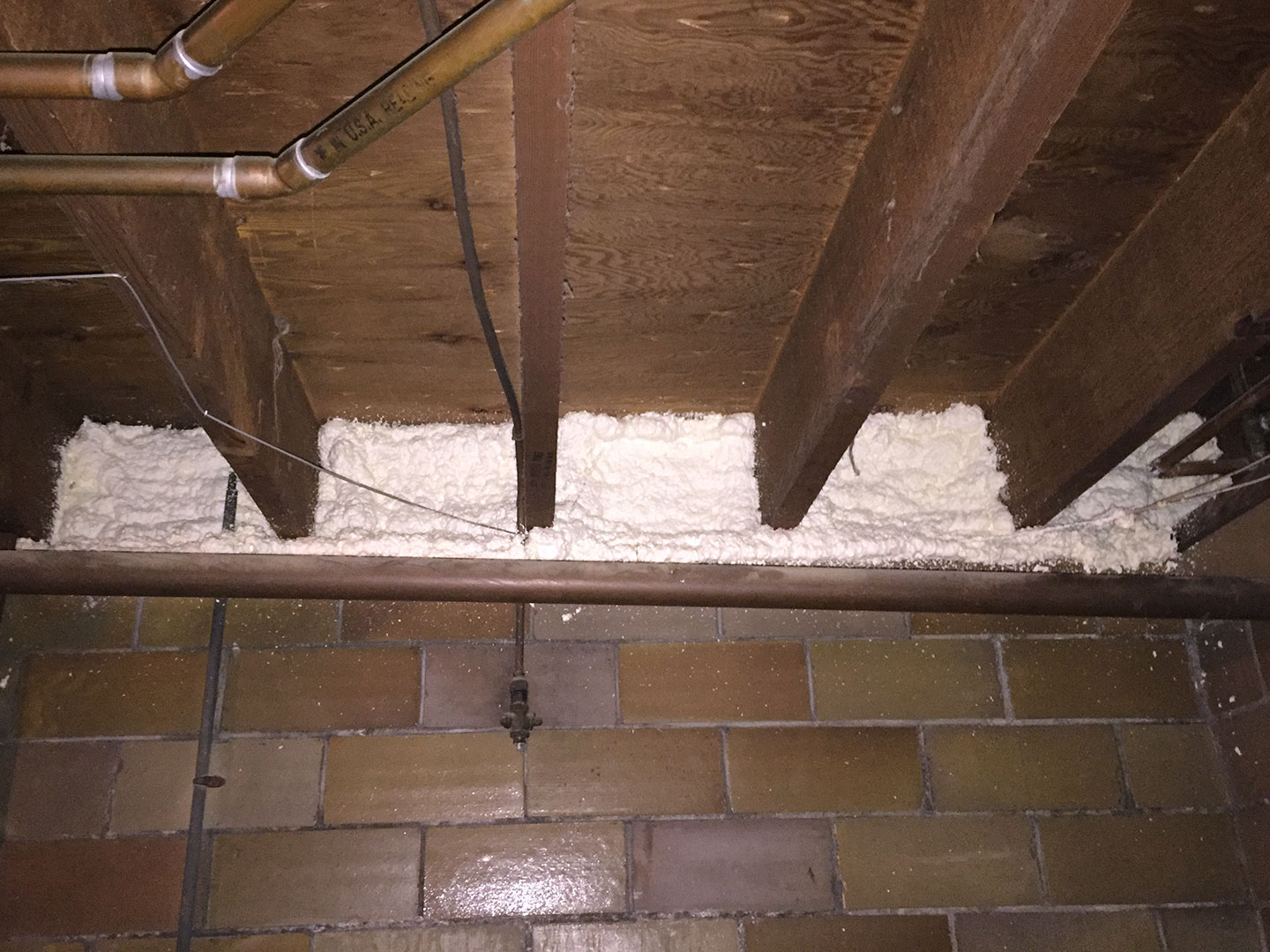 The rim joist is a large source of energy loss. The rim joist is the edge of the wood floor framing system that sits on top of the homes foundation walls. Spray foam air seals and insulates the rim joist making it the best material for insulating this area.