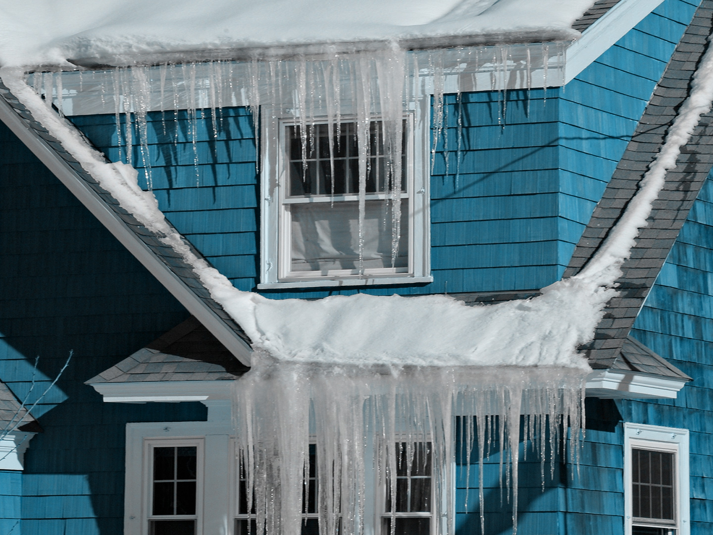 Home with icicles and and ice dam