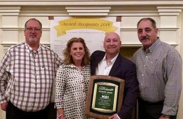 Richard Anderson, General Manager at Home Solutions of Iowa accepts Home Solutions of Iowa's 2018 Englert® Diamond Award.