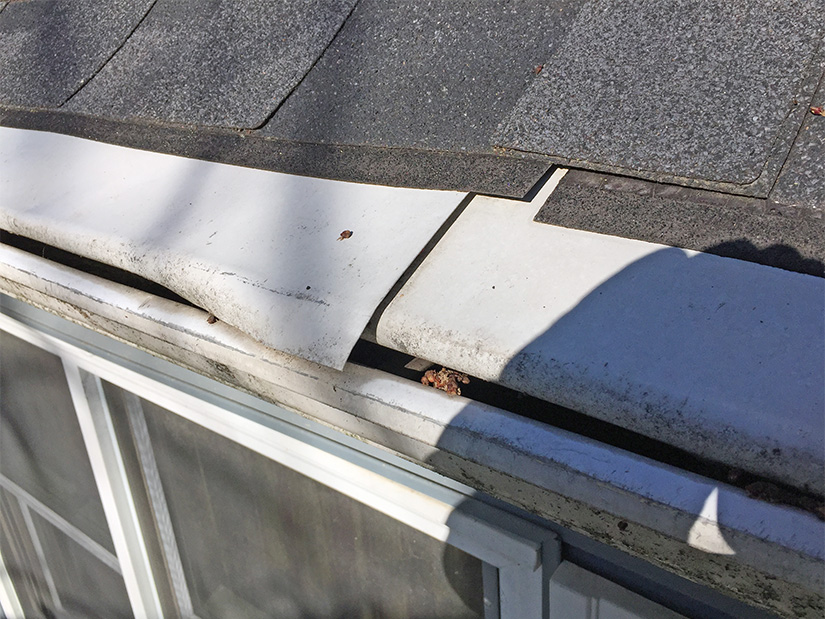 Damaged two-piece gutter system.