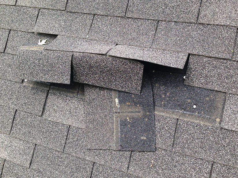 blown off shingles on a home