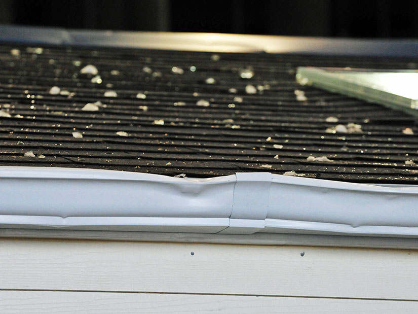 hail damage on gutters