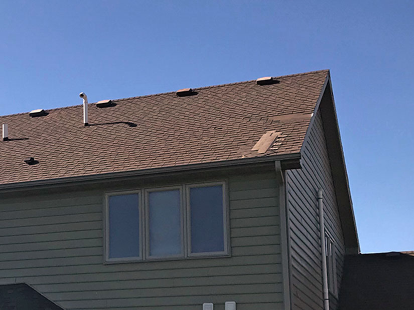 A recent storm damaged Adam's roof, siding and window.