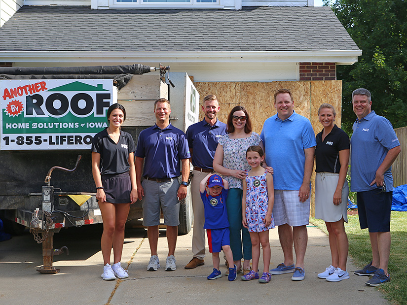 The team at Home Solutions of Iowa helped celebrate the installation of the Garman Family's new roof.