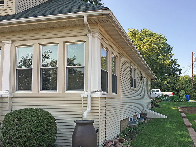 Pictured is an image of the curbside view of Rod's Dension, Iowa home before installing LeafGuard®.