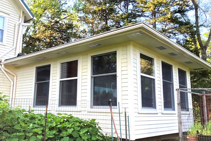 Side House With LeafGuard Gutters
