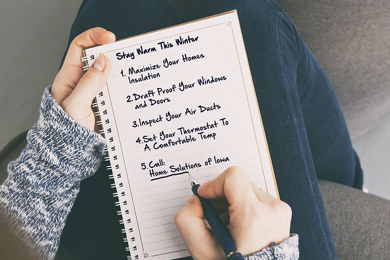 winterize home, winter checklist, person writing